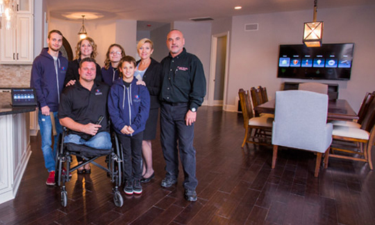 Wounded Army Green Beret MSG John Masson, his family, Judy Otter (Gary Sinise Foundation Director), and our founder, Joel Berrettini - Southern Pines, NC.